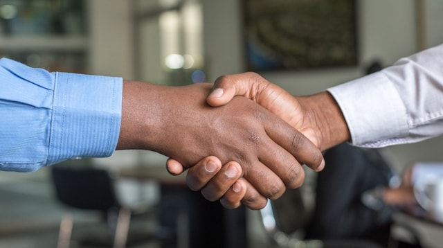 business-development-two-men-shaking-hands-min